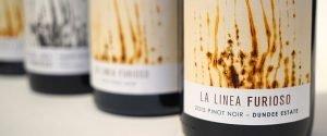 line of wine bottles